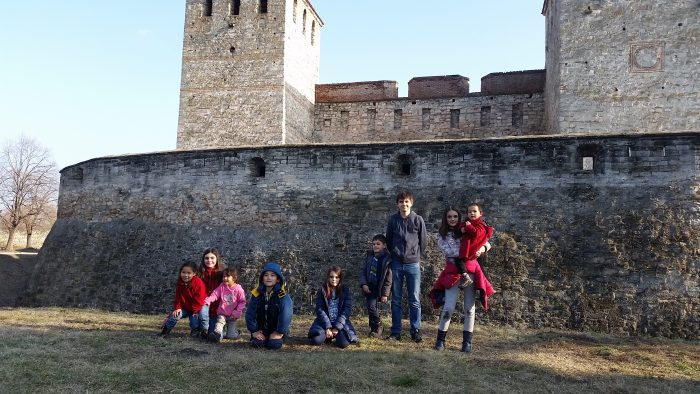 Kids in front of fortress